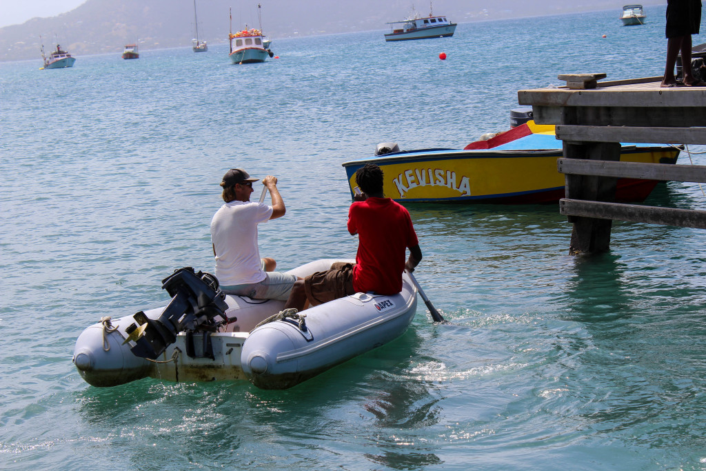 The outboard was acting up - Will elicited the help of locals in Petit St. Martinique